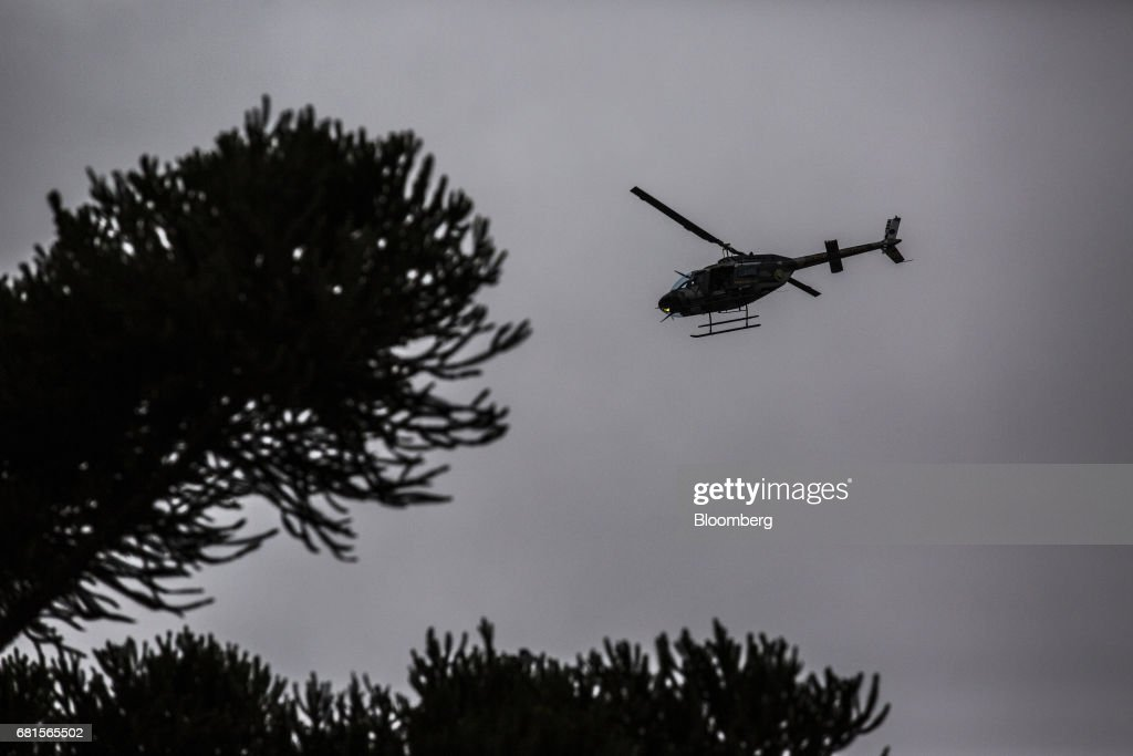 A police helicopter flies above the federal courthouse where Luiz Inacio Lula da Silva, former president of Brazil, is scheduled to testify before Sergio Moro, the lead jurist in the sprawling corruption probe known as Operation Carwash, in Curitiba, Brazil, on Wednesday, May 10, 2017. Thousands of Brazilians are descending on the southern city of Curitiba before a showdown between one of the most popular leaders in the country's history and its most famous judge at a hearing that could determine the republic's future. Photographer: Dado Galdieri/Bloomberg via Getty Images