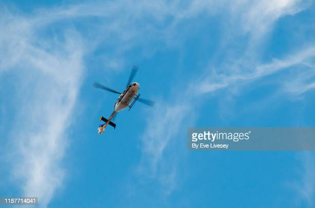 police helicopter flying over madrid - low section stock pictures, royalty-free photos & images