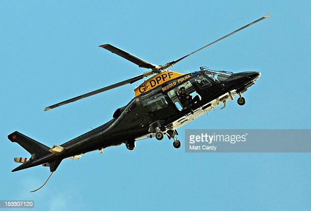 A police helicopter hovers above fields close to where Mark Bridger was arrested on October 3 2012 near Machynlleth Wales April Jones a fiveyearold...