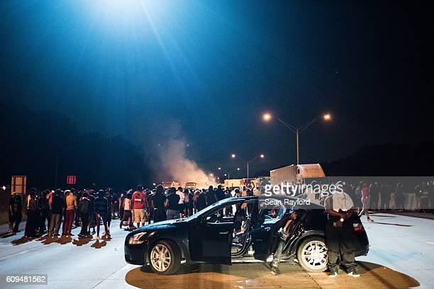 A police helicopter illuminates protestors blocking traffic on the I85 during protests in the early hours of September 21 2016 in Charlotte North...