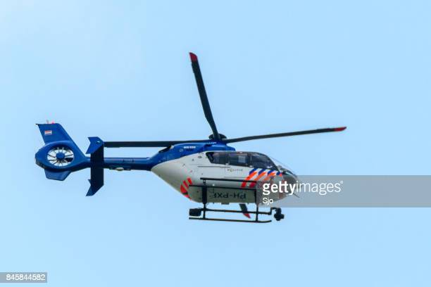 police helicopter of the dutch police aviation service fitted with camera's for surveillance. - infrared lamp stock photos and pictures