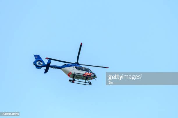police helicopter of the dutch police aviation service fitted with camera's for surveillance. - helicopter rotors stock photos and pictures