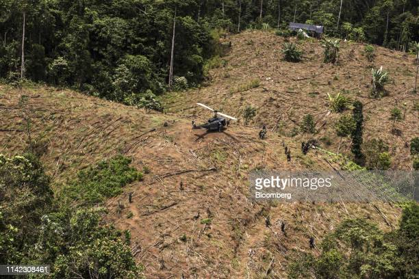 A police helicopter sits in a field during an antinarcotics operation in Tumaco Narino department Colombia on Tuesday May 8 2019 Production of coca...