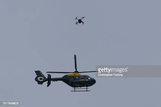Police heliopter and a drone watch over protesters outside Old Trafford Stadium ahead of the Premier League match between Manchester United and...