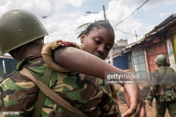 Police help a girl from Gitanga Primary school after she was caught between opposition supporters and police who were clashing after Cabinet...