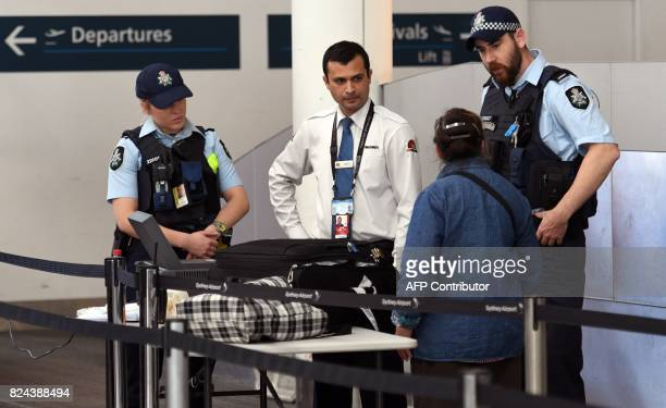 Police help screen passengers at Sydney Airport on July 30 2017 Australia has foiled an Islamistinspired 'terrorist plot' to bring down an airplane...