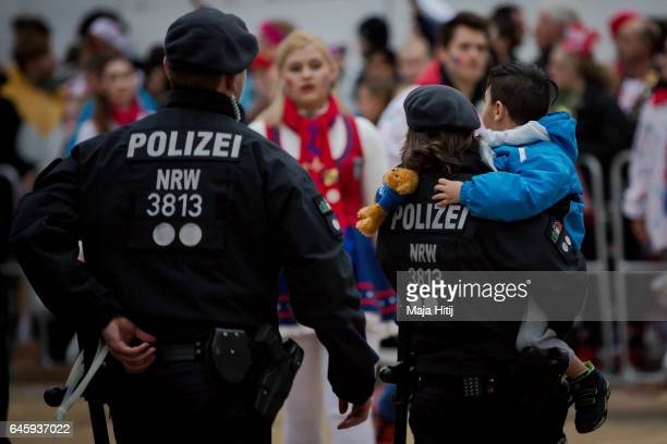 Police helps a boy find his parents during Rose Monday parade on February 27 2017 in Cologne Germany Political satire is a traditional cornerstone of...