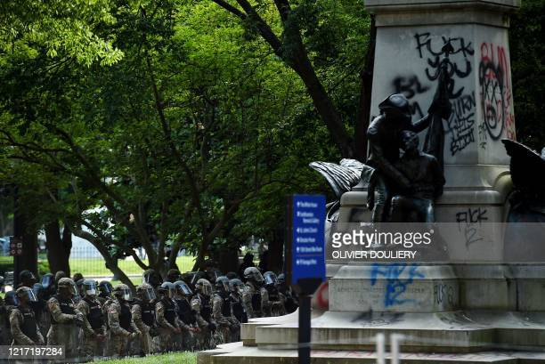 Police hold a perimeter at Lafayette Square near the White House as demonstrators gather to protest the killing of George Floyd on June 2 2020 in...