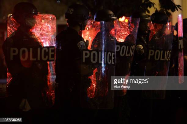 Police hold a perimeter near the White House as demonstrators gather to protest the killing of George Floyd in the morning hours on May 31 2020 in...