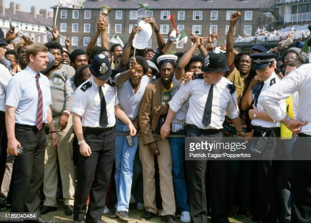 Police hold back a celebratory crowd after West Indies win the 5th Test match between England and West Indies by 172 runs at The Oval, London, 14th...