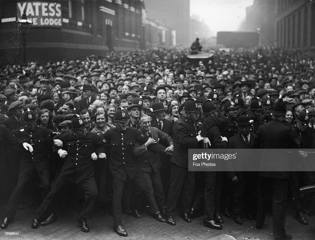 Police hold back a crowd of sightseers outside Strangeways gaol in Manchester before the execution of Dr Buck Ruxton for the murder of his wife and her maid.