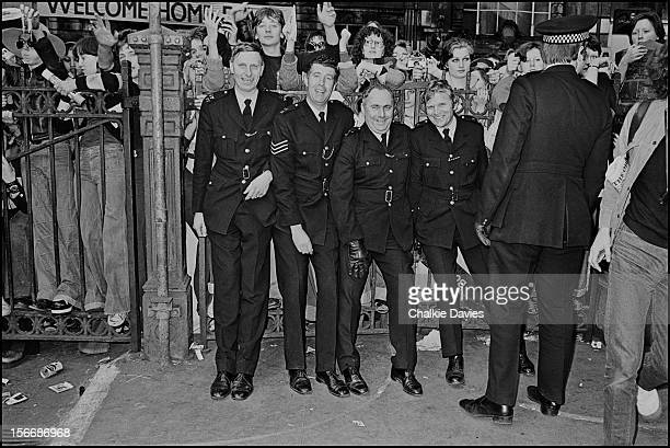 Police hold back crowds of fans waiting at Victoria Station for the arrival of David Bowie London 2nd May 1976