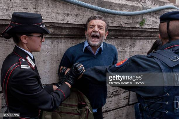 Police hold back demonstrators of the No War Network protesting U.S. President Donald Trump upon his departure of the Quirinale Presidential Palace...