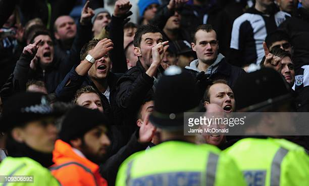 Police hold back fans of West Bromwich Albion during the Barclays Premier League match between West Bromwich Albion and Wolverhampton Wanderers at...