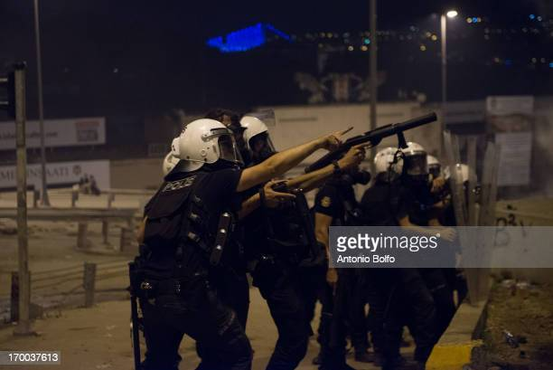 Police hold back protestors from Besiktas June 3 2013 in Istanbul Turkey People started peacefully protesting the government's project to tear down...
