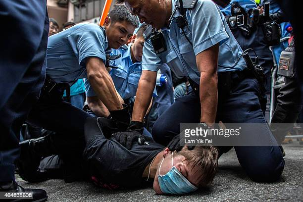 Police hold down a protester in Yuen Long during a rally against parallelgoods trading on March 1 2015 in Hong Kong Hong Kong Protestors say the...