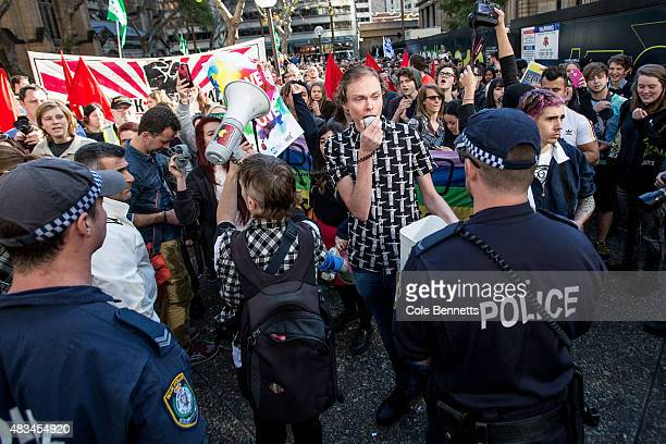 Police hold off protestors during a rally for marriage equality at Sydney Town Hall on August 9 2015 in Sydney Australia They are specifically...