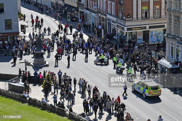 Police hold up the traffic for a coach arriving ahead of the funeral of Prince Philip, Duke of Edinburgh at Windsor Castle on April 17, 2021 in...