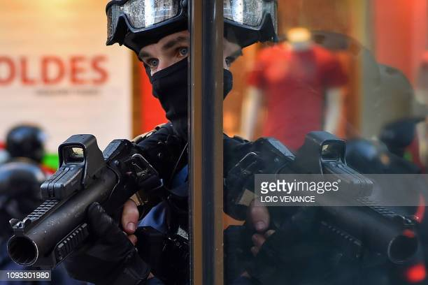 Police holds a 40-millimetre rubber defensive bullet launcher LBD on February 2, 2019 in Nantes during a demonstration called nationwide by the...