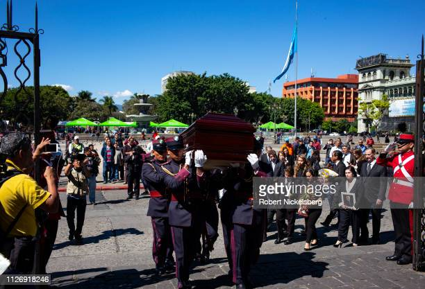 Police honor guard carries the casket of former Guatemalan Vice President Juan Francisco Reyes, 1939-2019, during a funeral service held at the Roman...