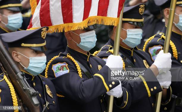 Police honor guard stand guard as the casket of the late Glen Ridge Police Officer Charles Rob Roberts who died of coronavirus weeks after...