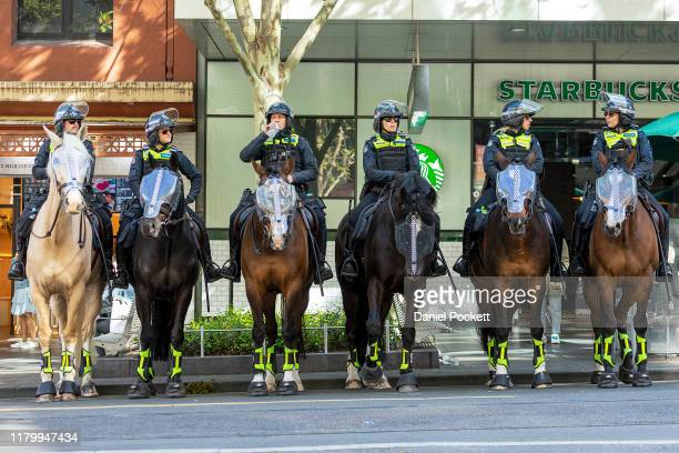 Police horses are seen during protests in on October 09 2019 in Melbourne Australia The event was organised as part of Extinction Rebellion's global...