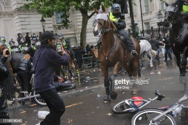 Police Horses are used in an attempt to disperse protesters during a Black Lives matter march through central London on June 6 2020 in London United...