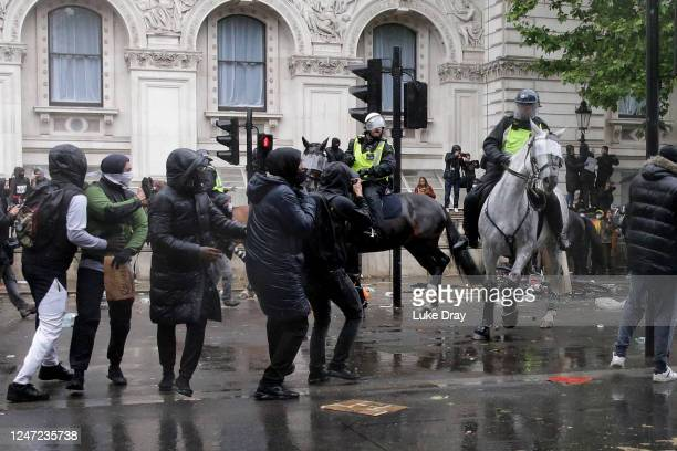 Police Horses are used in an attempt to disperse protesters during a Black Lives matter march through central London on June 6, 2020 in London,...