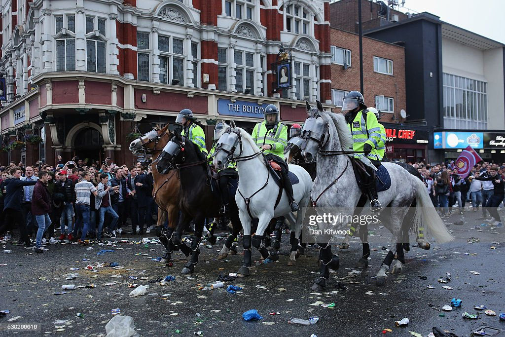 Police horses as West Ham fans become violent and start throwing bottles at police outside West Ham United FC's Boleyn Ground on May 10, 2016 in London, England. Tonights Premier League match against Manchester United is the last game at the Boleyn Ground, bringing to an end 112 years of the clubs history at the ground. The club will move into the Olympic Stadium next season, making way for developers and plans for 800 new homes where the stadium now stands.