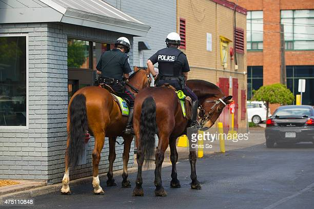 Police horses Blue Jay left and Moose wait patiently for their handlers from the Toronto Police Service Mounted Unit to get their coffee at a ride...