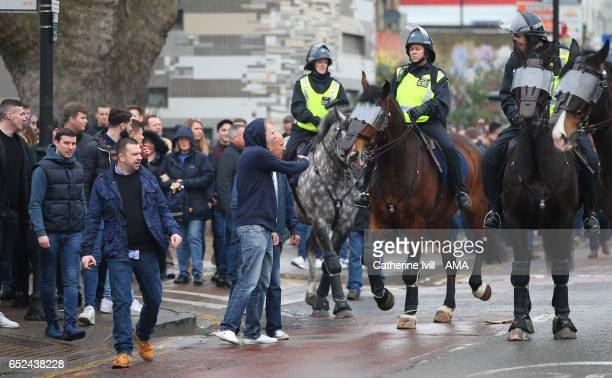 Police horses escort the Millwall fans up the road ahead of The Emirates FA Cup QuarterFinal match between Tottenham Hotspur and Millwall at White...