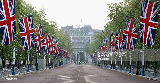 Police horses on The Mall bedecked with Union Flags following a dress rehearsal of the royal carriage procession from Westminster Hall to Buckingham...