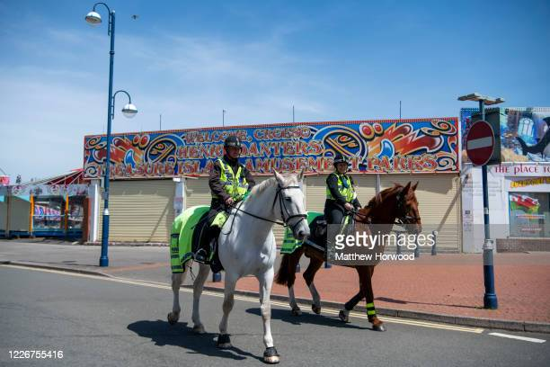 Police horses patrol at Barry Island on May 24 2020 in Barry United Kingdom The British government has started easing the lockdown it imposed two...