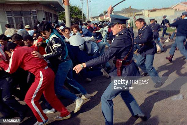 Police horsewhip demonstrators in order to break up a march to Nelson Mandela's prison