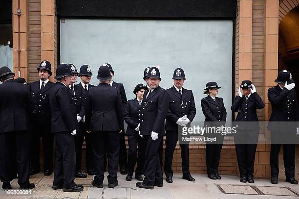 Police in ceremonial uniform prepare for the funeral cortege of former British Prime Minister Baroness Thatcher on April 17 2013 in London England...
