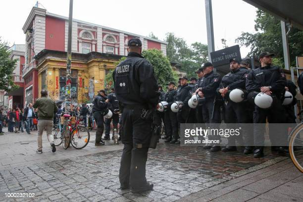 Police in riot gear accompany a demonstration through HamburgGermany 29 June 2017 The spontaneous demonstration was in response to police house...