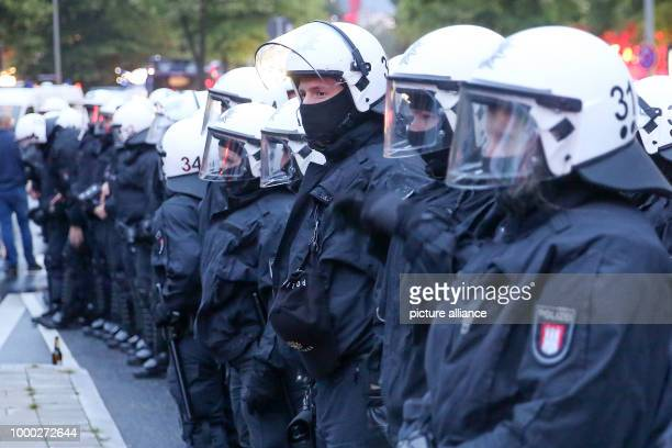 ARCHIVE Police in riot gear accompany a demonstration through HamburgGermany 29 June 2017 The spontaneous demonstration was in response to police...