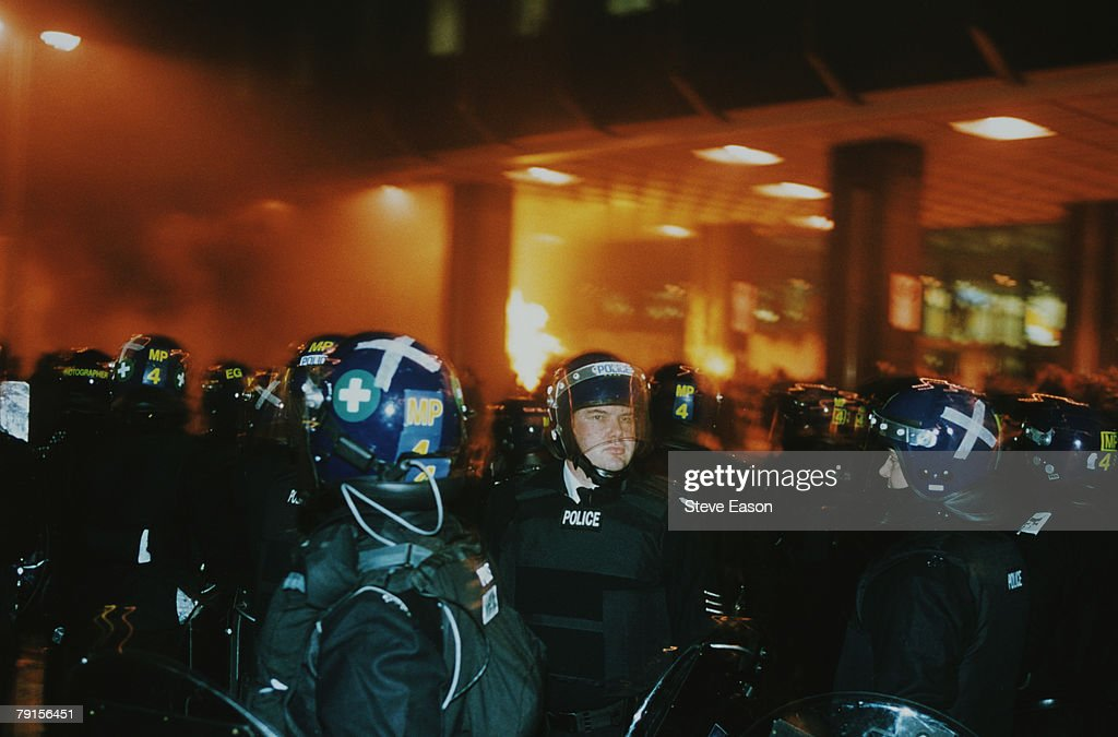 Police in riot gear attend a disturbance outside the Railtrack headquarters, Euston Station, at an anti World Trade Organisation protest during a Reclaim The Streets event, 30th November 1999. The event had been organised on the internet by the N30 group.