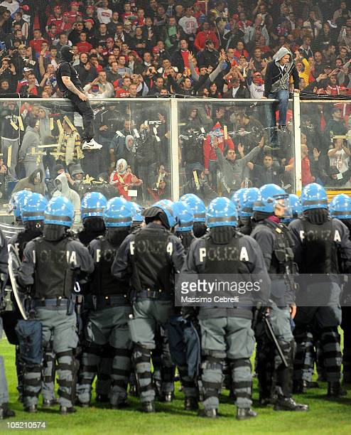 Police in riot gear confront Serbia fans during the UEFA EURO 2012 Group C qualifier between Italy and Serbia at Luigi Ferraris Stadium on October 12...