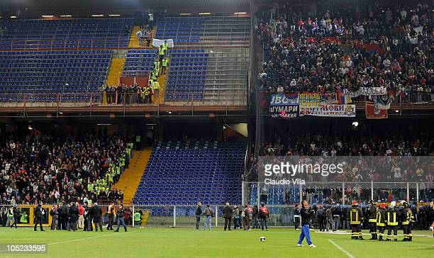 Police in riot gear confront Serbia fans during the UEFA Euro 2012 qualifying match between Italy and Serbia at Luigi Ferraris Stadium on October 12...