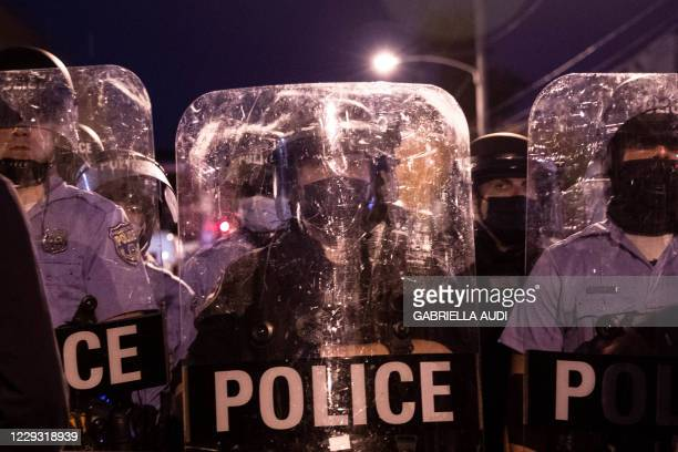 Police in riot gear face protesters marching through West Philadelphia on October 27 during a demonstration against the fatal shooting of 27yearold...
