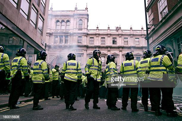 CONTENT] Police in riot gear face protesters on Piccadilly W1 shortly before the occupation of Fortnum and Mason' during a demonstration Against the...