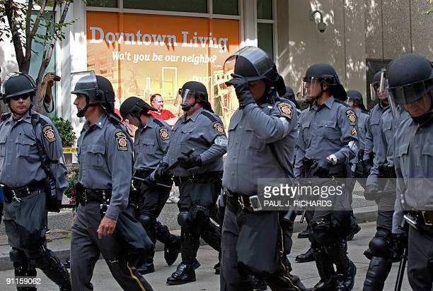 Police in riot gear follow protestors on the streets of downtown Pittsburgh Pennsylvania just a few blocks from the G20 Summit on September 25 2009...