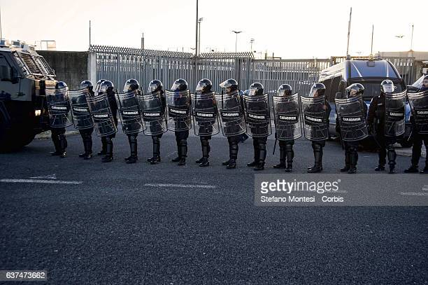 Police in riot gear in front of the Cie during demonstration against the Center for Identification and Expulsion for immigrants to Ponte Galeria to...
