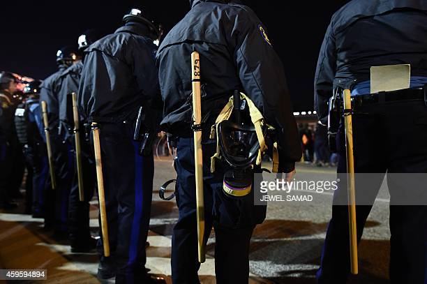 Police in riot gear line up against protesters in Ferguson Missouri on November 25 2014 during demonstrations a day after violent protests and...