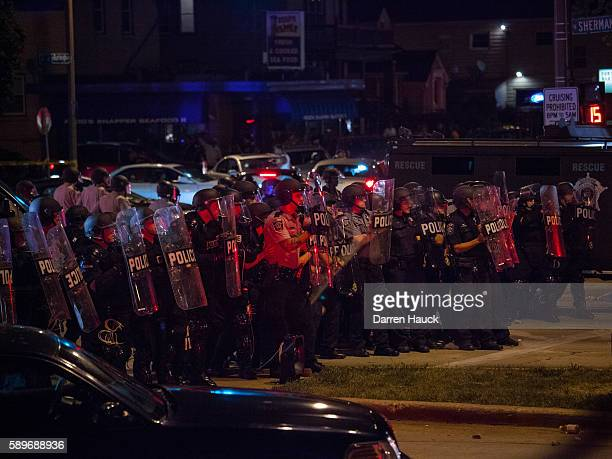 Police in riot gear line up as angry crowds took to the streets for a second night to protest an officerinvolved killing August 14 2016 in Milwaukee...