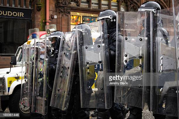CONTENT] Police in riot gear move into Chichester Street during a protest by loyalists at City Hall in Belfast Northern Ireland on January 5 2013 The...