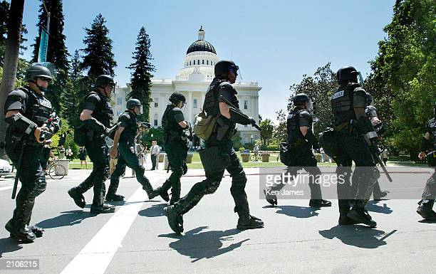 Police in riot gear move into position as protesters numbering around 2000 demonstrated against the Ministerial Conference and Expo on Agricultural...