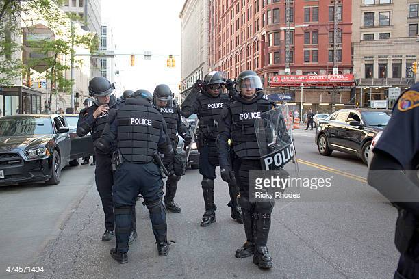 Police in riot gear organize on E 9th St as people take to the streets and protest in reaction to Cleveland police officer Michael Brelo being...