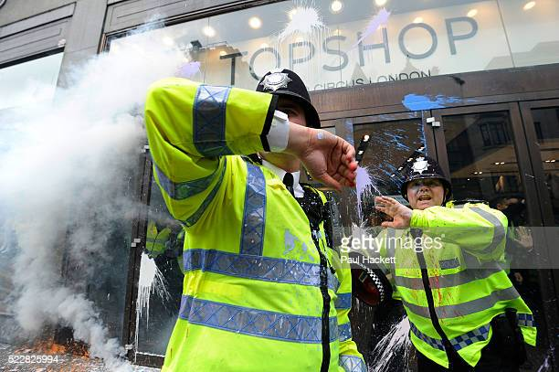 Police in riot gear protecting Topshop on Oxford Street as Anti capitalists / anarchists go on the rampage on the back of the peaceful TUC protest...